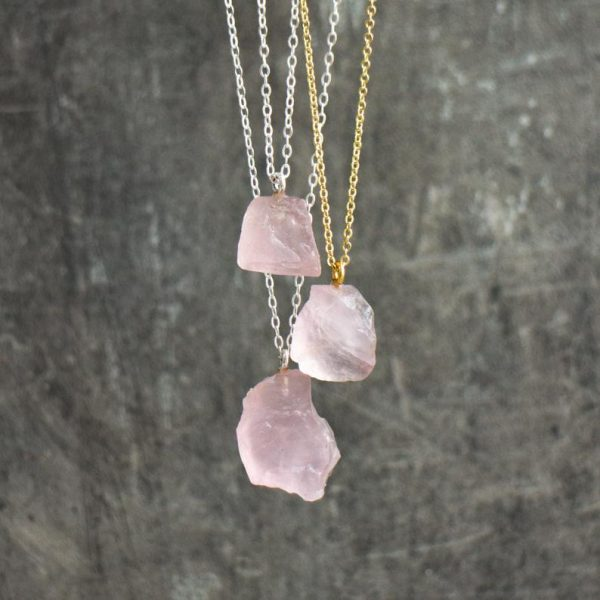 Raw rose quartz necklace with different silver and gold chains