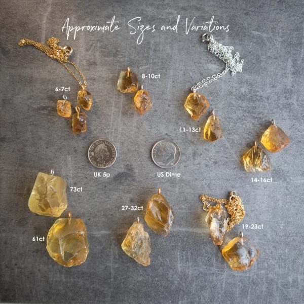Citrine gemstone pendants scale with a dime and 5-