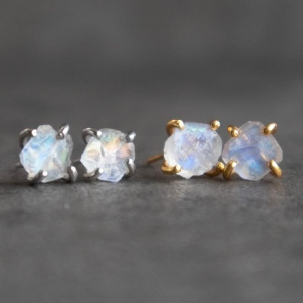 Moonstone earrings, raw stones with different sizes close up