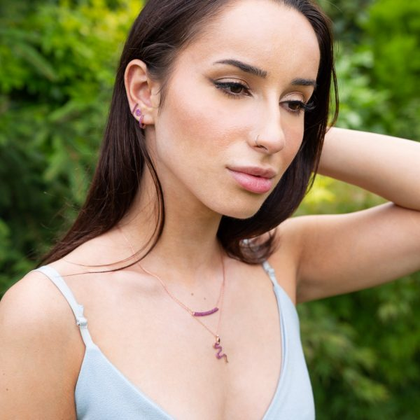 Snake necklace and ruby necklace on model