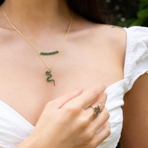 Snake Necklace layered with Emerald Bar Necklace on model