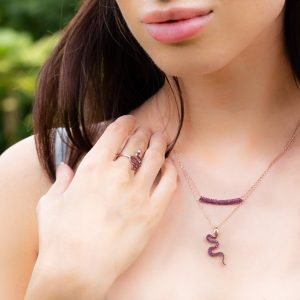 Snake Necklace in Ruby, layered with ruby bar necklace on model